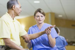 hand specialist with patient
