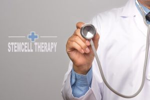 Doctor holding a stethoscope and word STEMCELL THERAPY