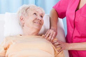 Elderly lady during rehabilitation after orthopedic surgery