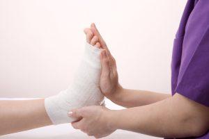 Nurse is Bandaging foot